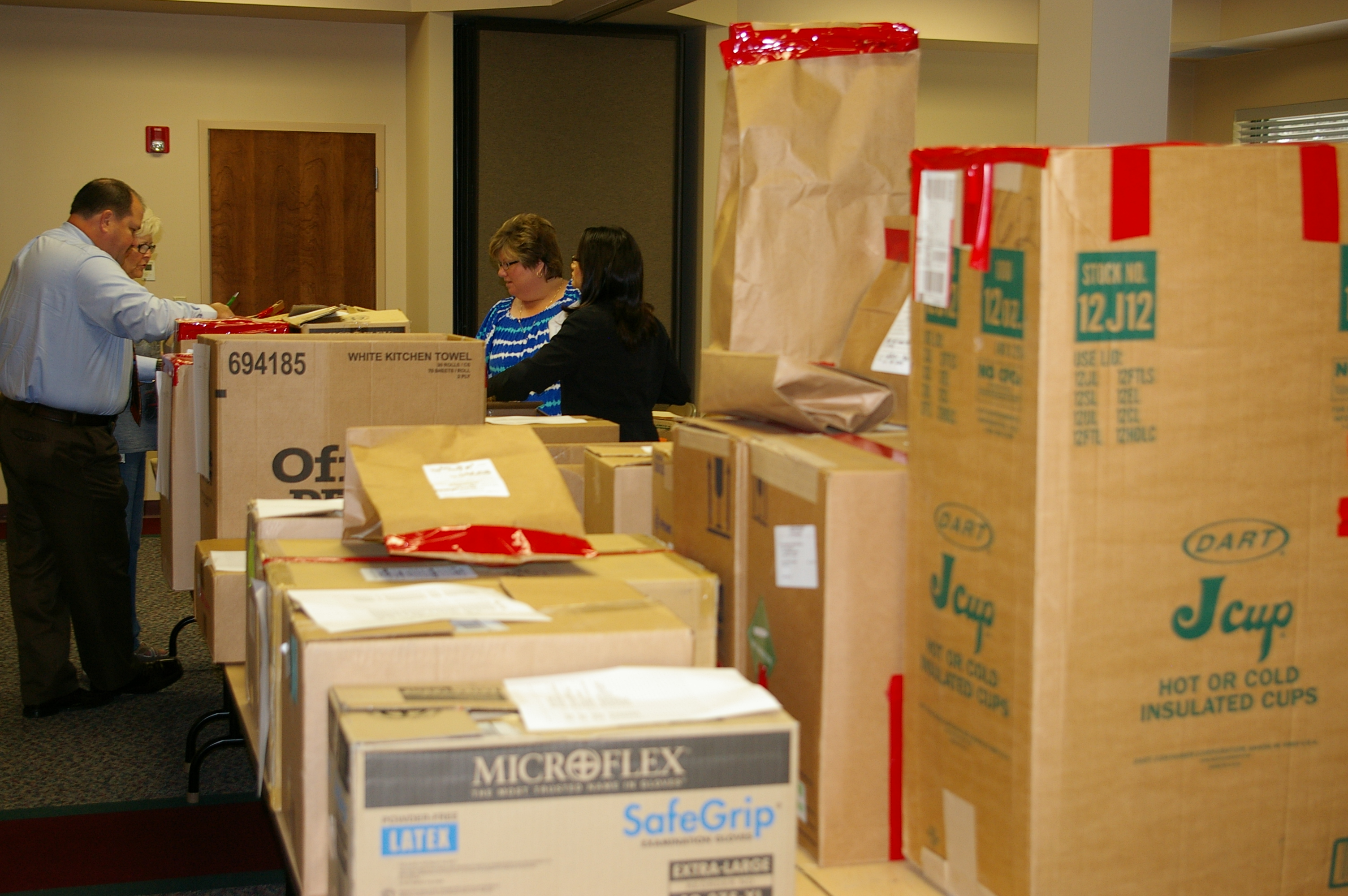 Boxes of drugs and drug related crimes line tables for inspection