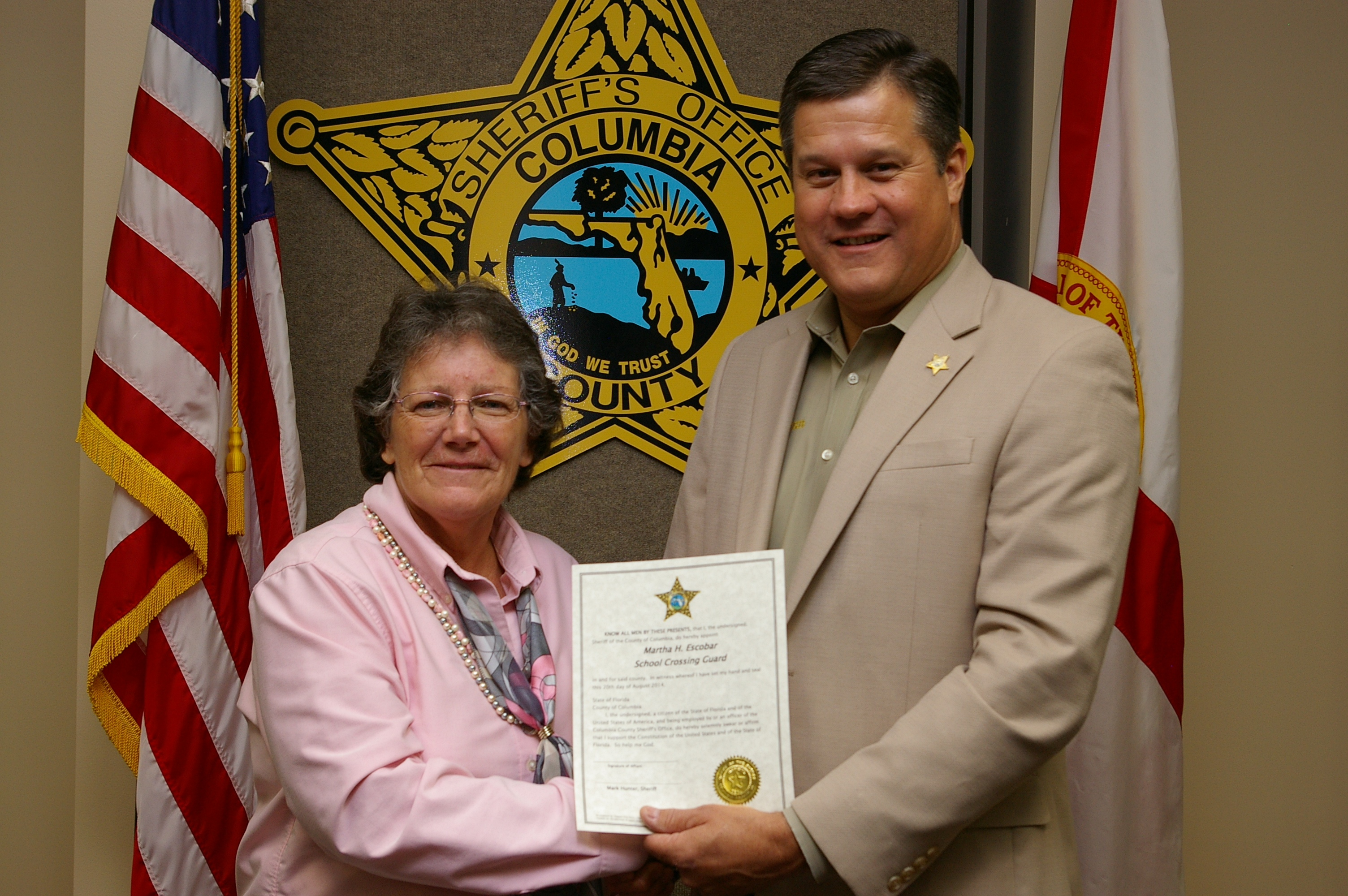 Ms. Martha Escobar and Sheriff Mark Hunter