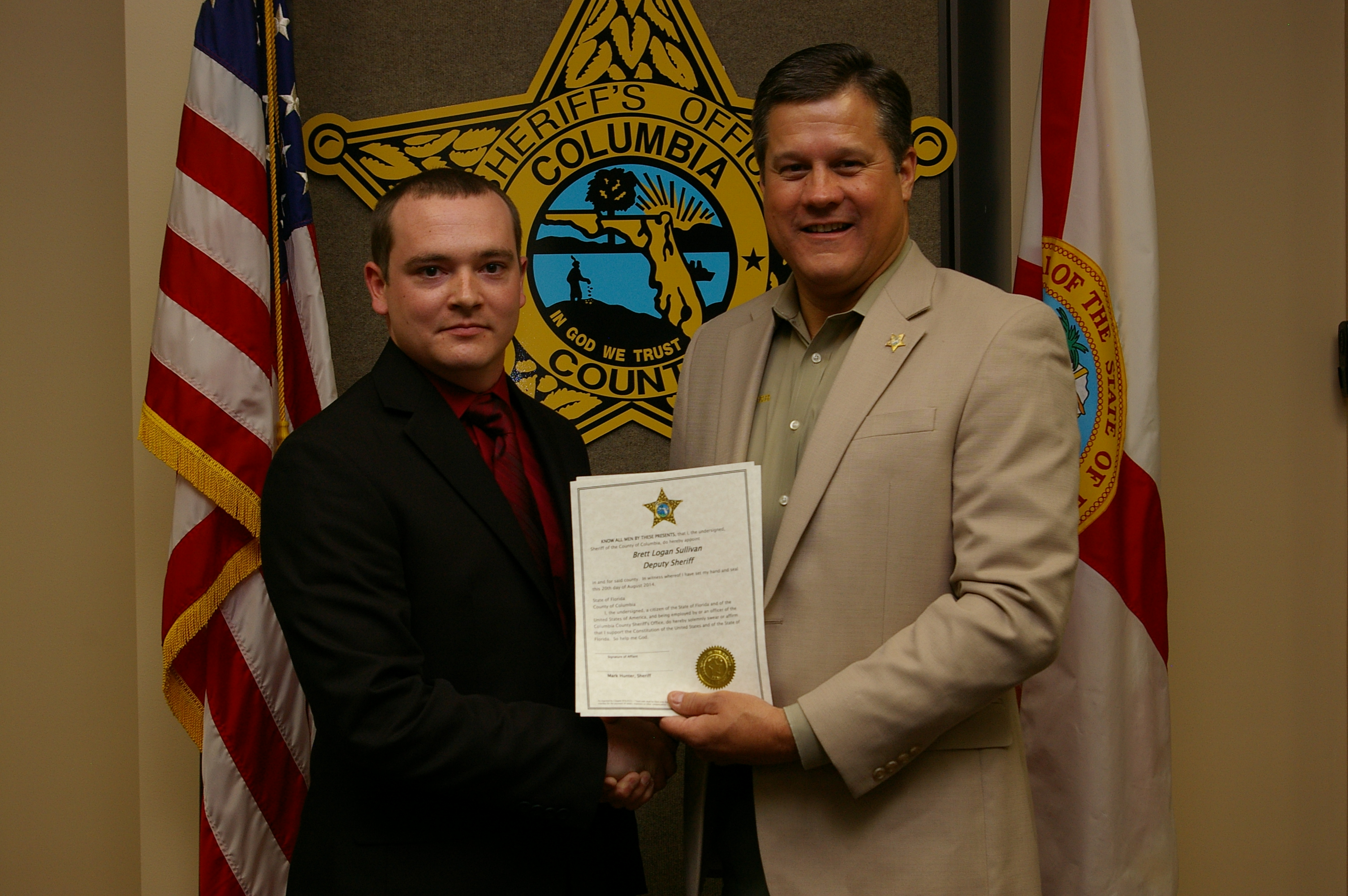 Deputy Sheriff Brett Sullivan  and Sheriff Mark Hunter