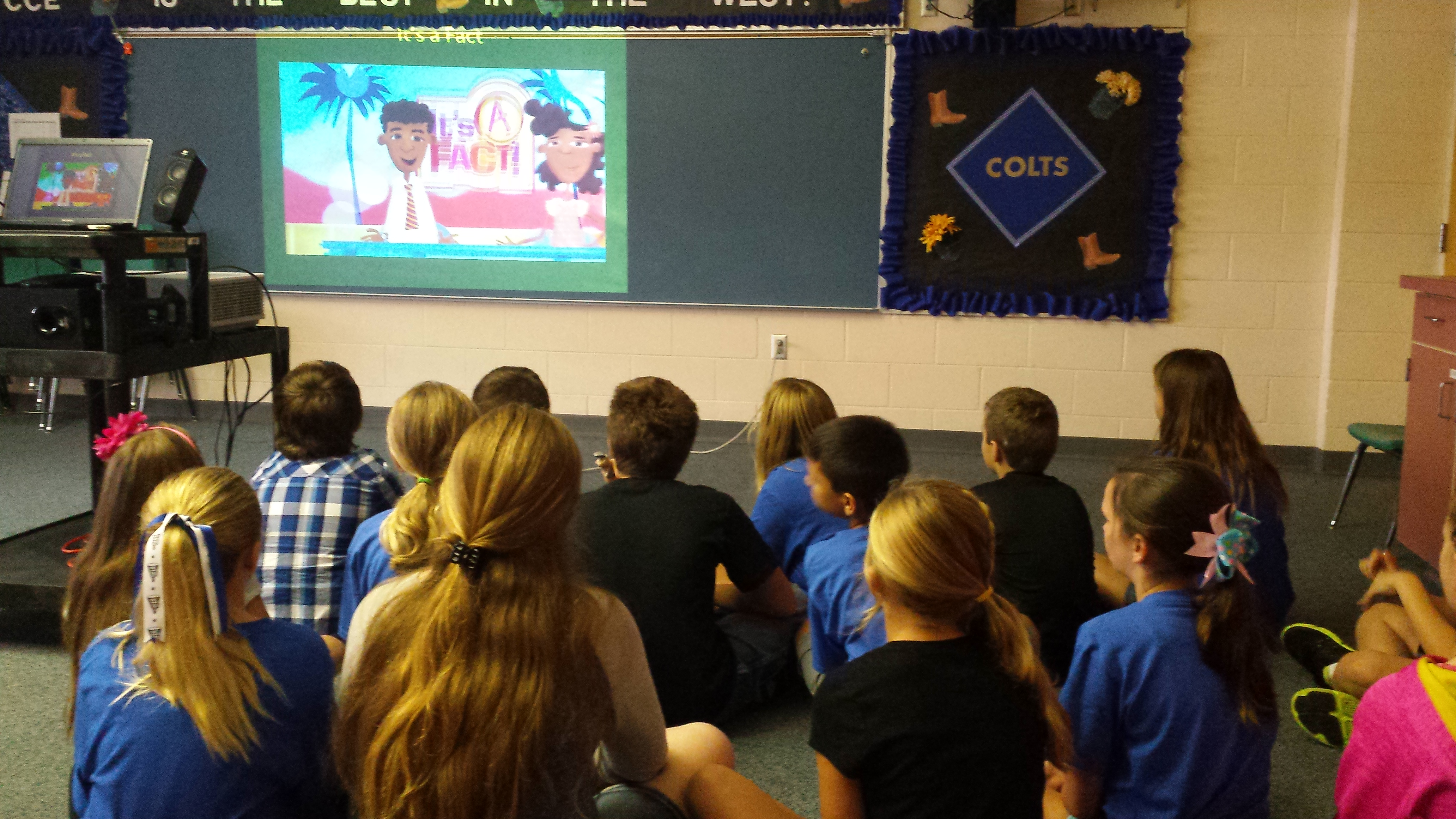 Students watch a video on personal responsibility and respect