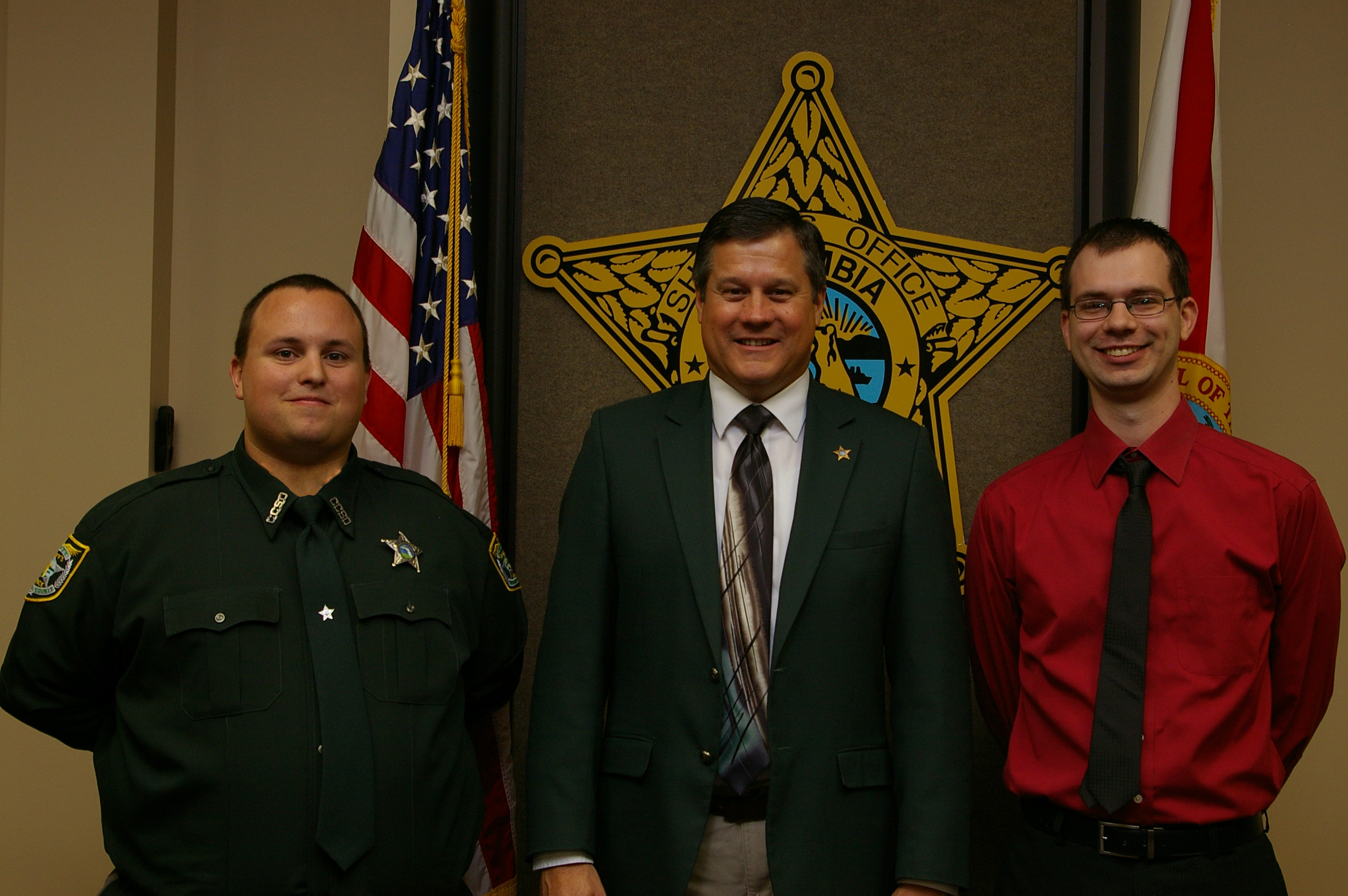 Detention Deputy Evan Brand, Sheriff Mark Hunter, and Mr. John Hartzog
