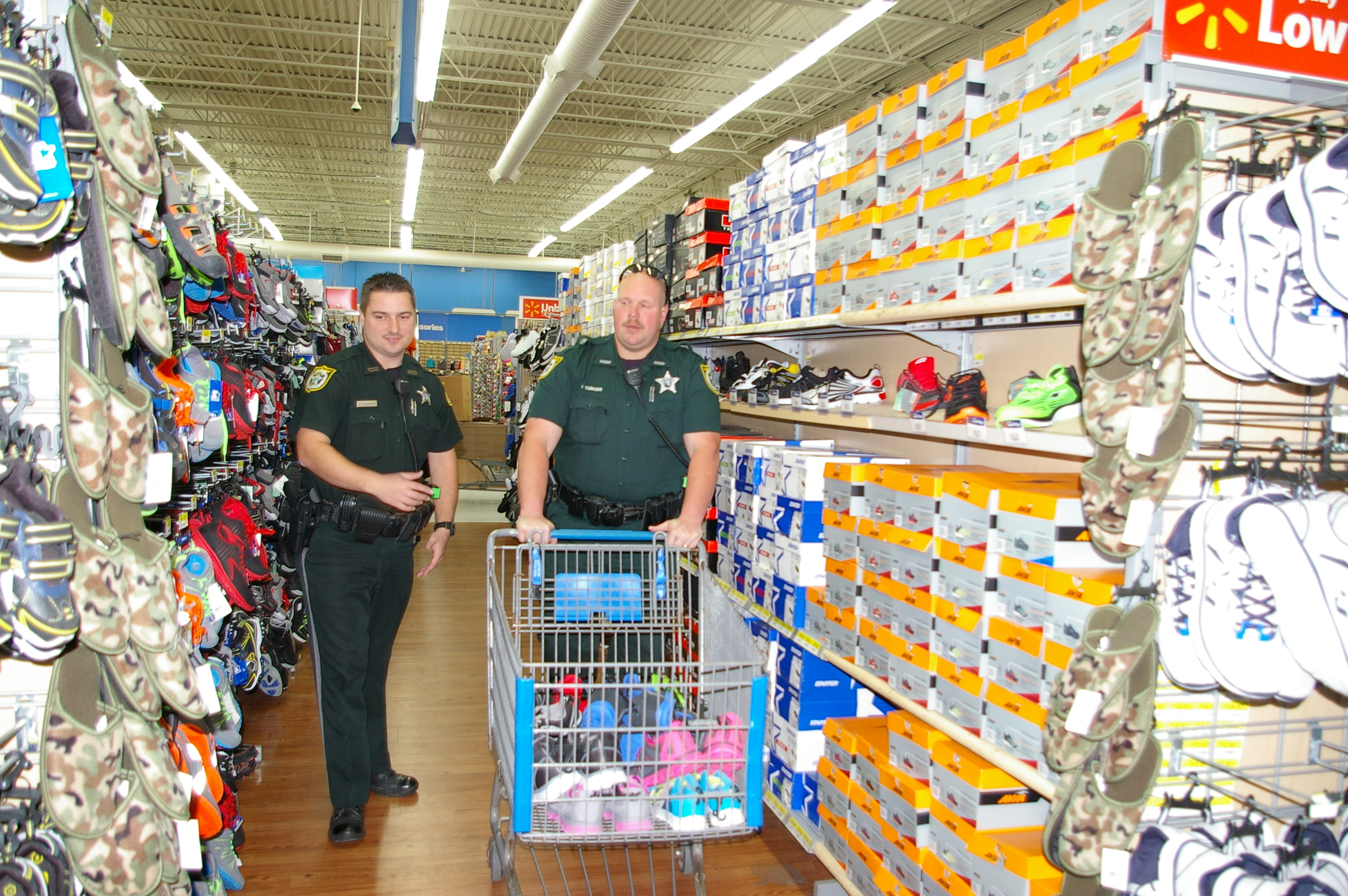 Deputies Chris Parker and Richard Conger shop for the kids