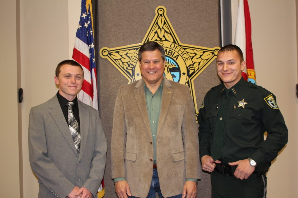 Deputy Sheriff Aaron Green, Sheriff Mark Hunter, and Detention Deputy Cornelius Lorton