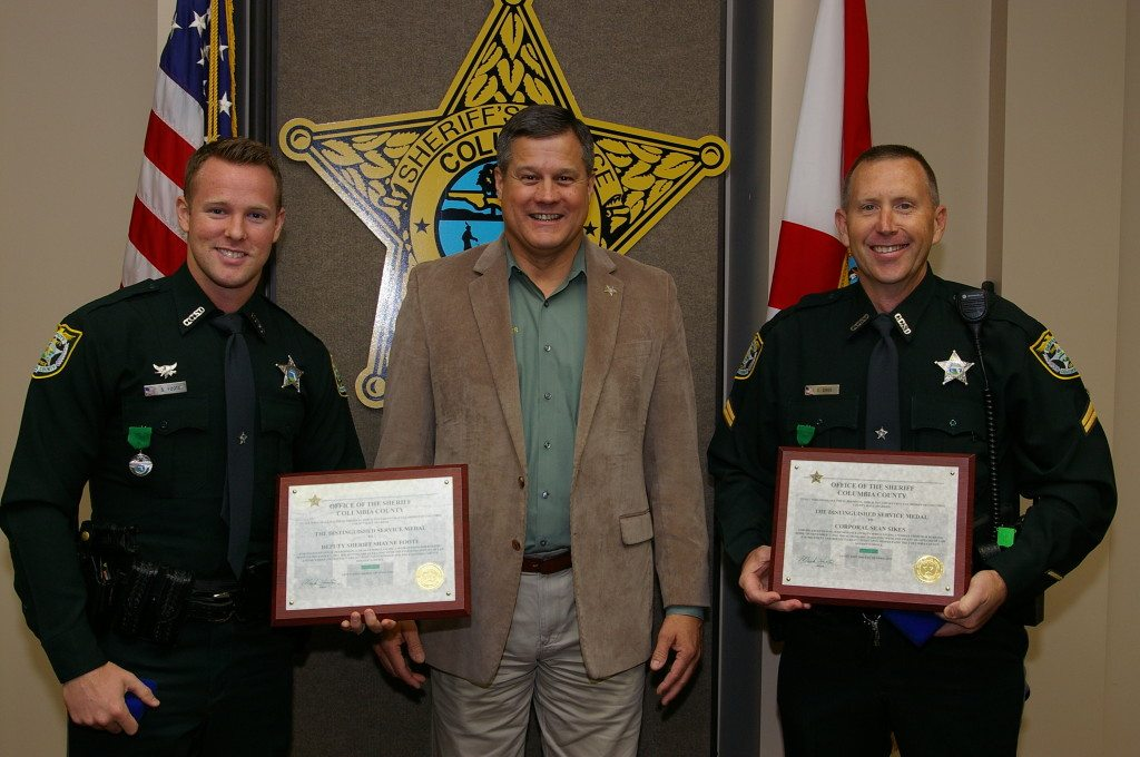 Deputy Shayne Foote, Sheriff Mark Hunter and Corporal Sean Sikes