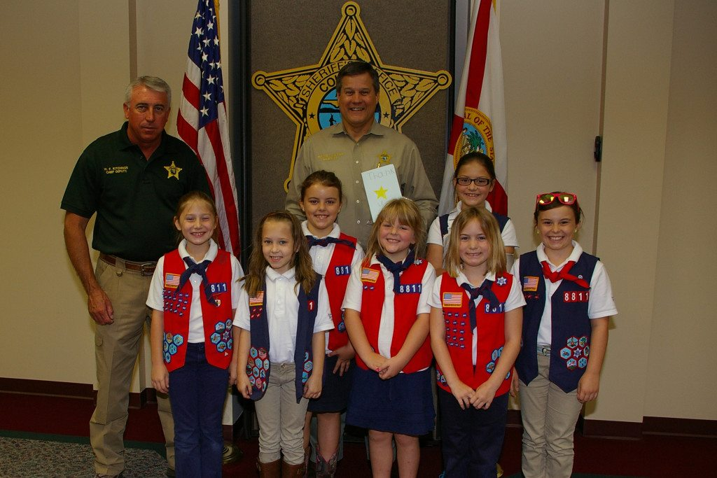Chief Deputy Wallace Kitchings and Sheriff Mark Hunter are pictured with girls from Troop FL8811 of the American Heritage Girls