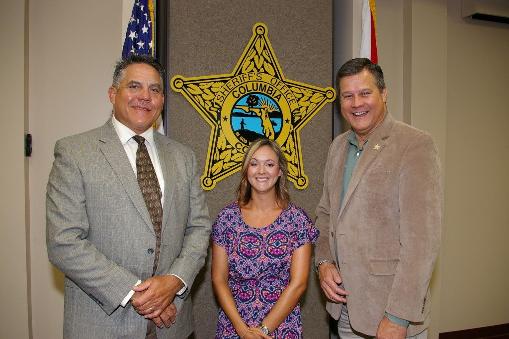 Detention Deputy Chris Douglas, Ms. Ashley Stalvey, and Sheriff Mark Hunter