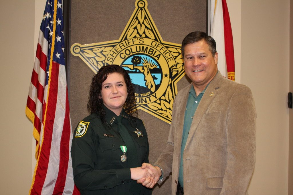 Detention Deputy Mackenzie Guerra and Sheriff Mark Hunter