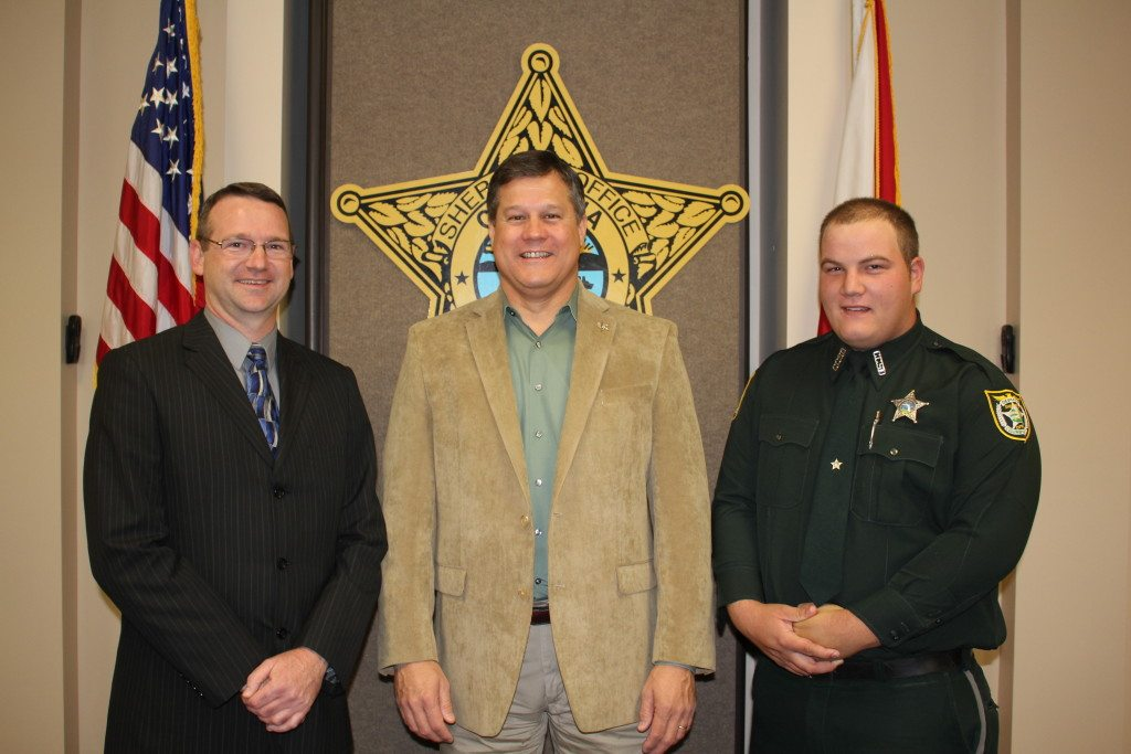 Deputy Thomas Norris, Sheriff Mark Hunter, and Detention Deputy Aaron Rose