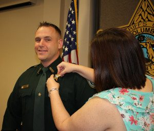 Sergeant Spradley smiles as his wife pins on his new Sergeant Star